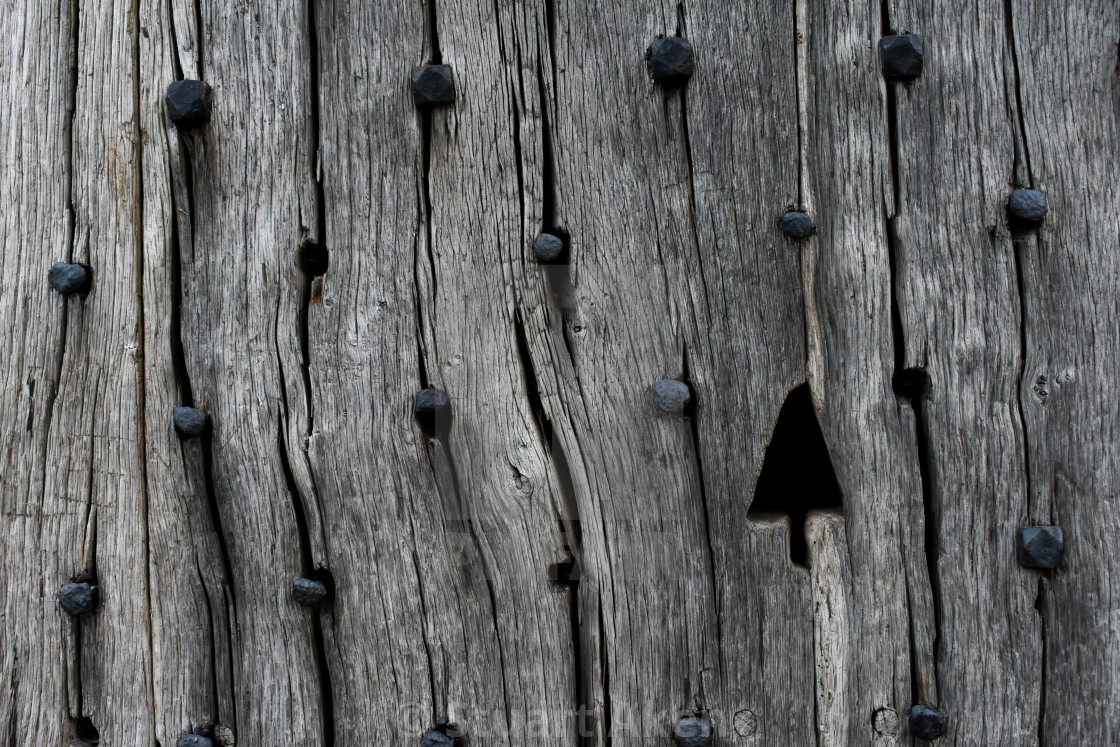 """Detail of Ancient Wooden Door"" stock image"