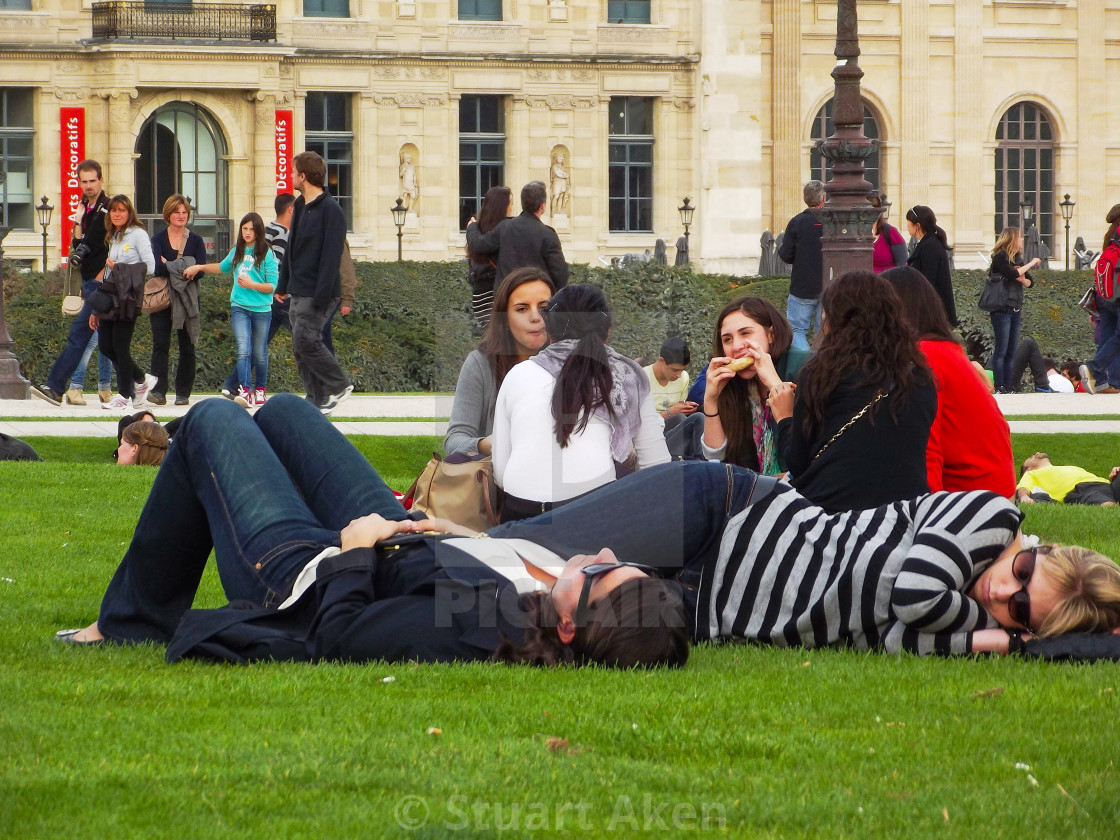 """Relaxing on the Grass in Paris"" stock image"