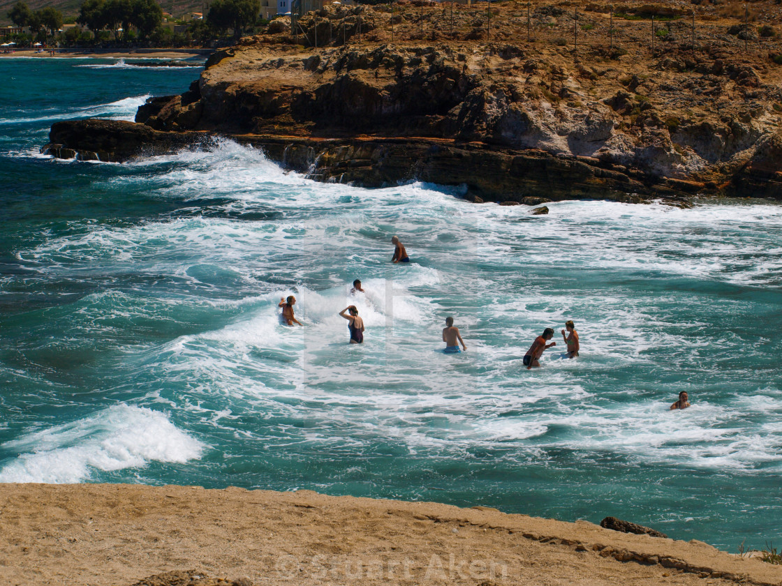 """Avlaki Beach with Swimmers"" stock image"