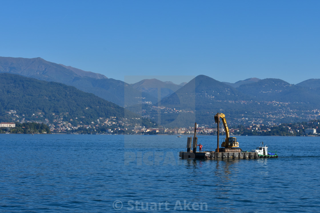 """Dredger on Lake Maggiore in Italy"" stock image"