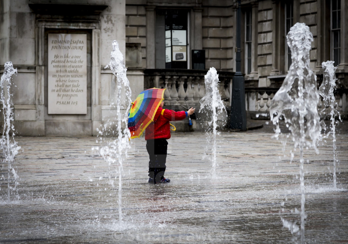 """Child playing with fountains"" stock image"
