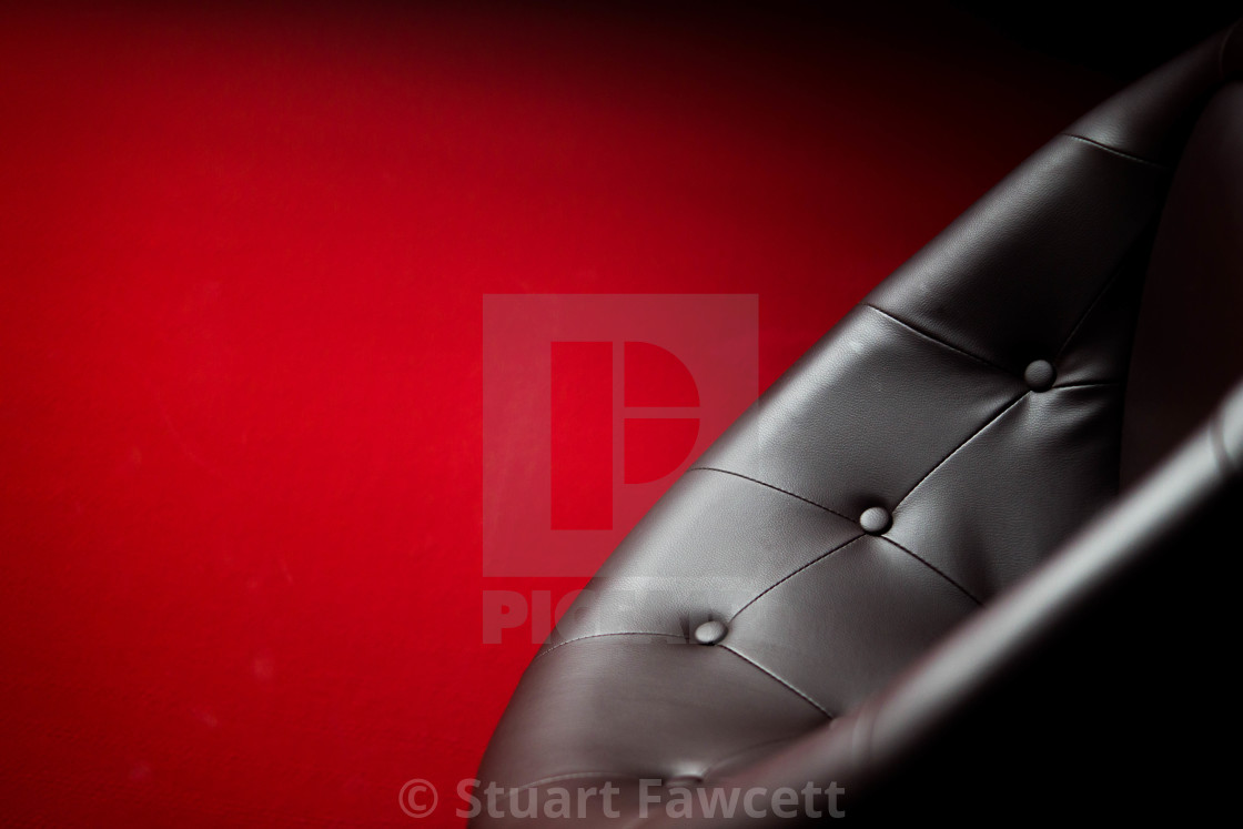 """Black chair on red"" stock image"