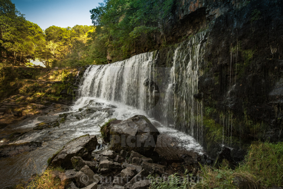 """Sgwd Isaf Clun-gwyn (Lower fall of the white meadow) Brecon Beacons Waterfall"" stock image"