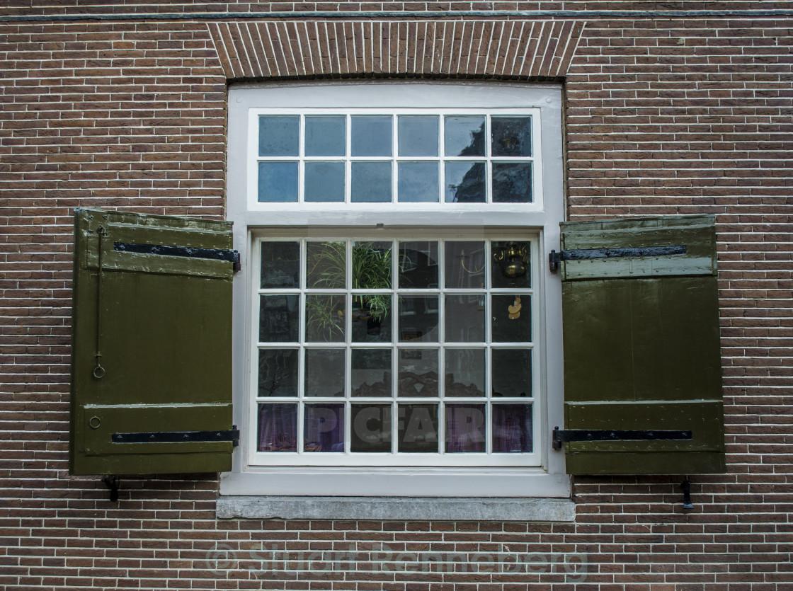 Georgian style window frame on brick house in Amsterdam - License ...