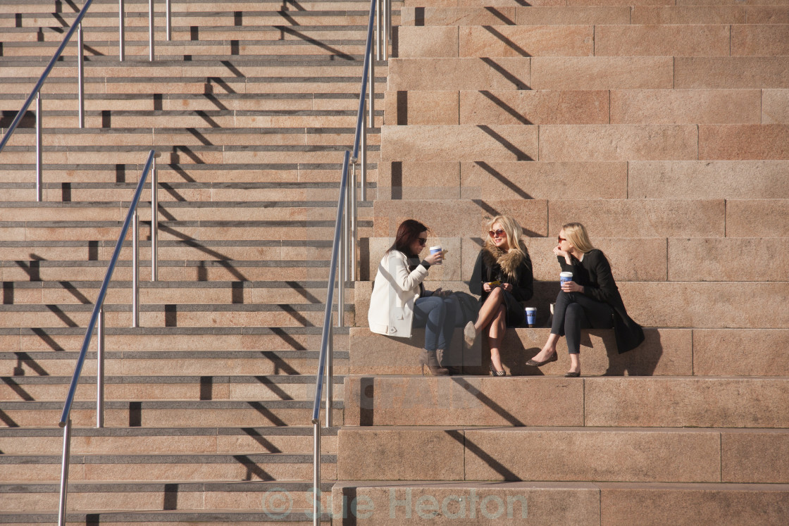 """People relaxing in the sunshine in Liverpool."" stock image"