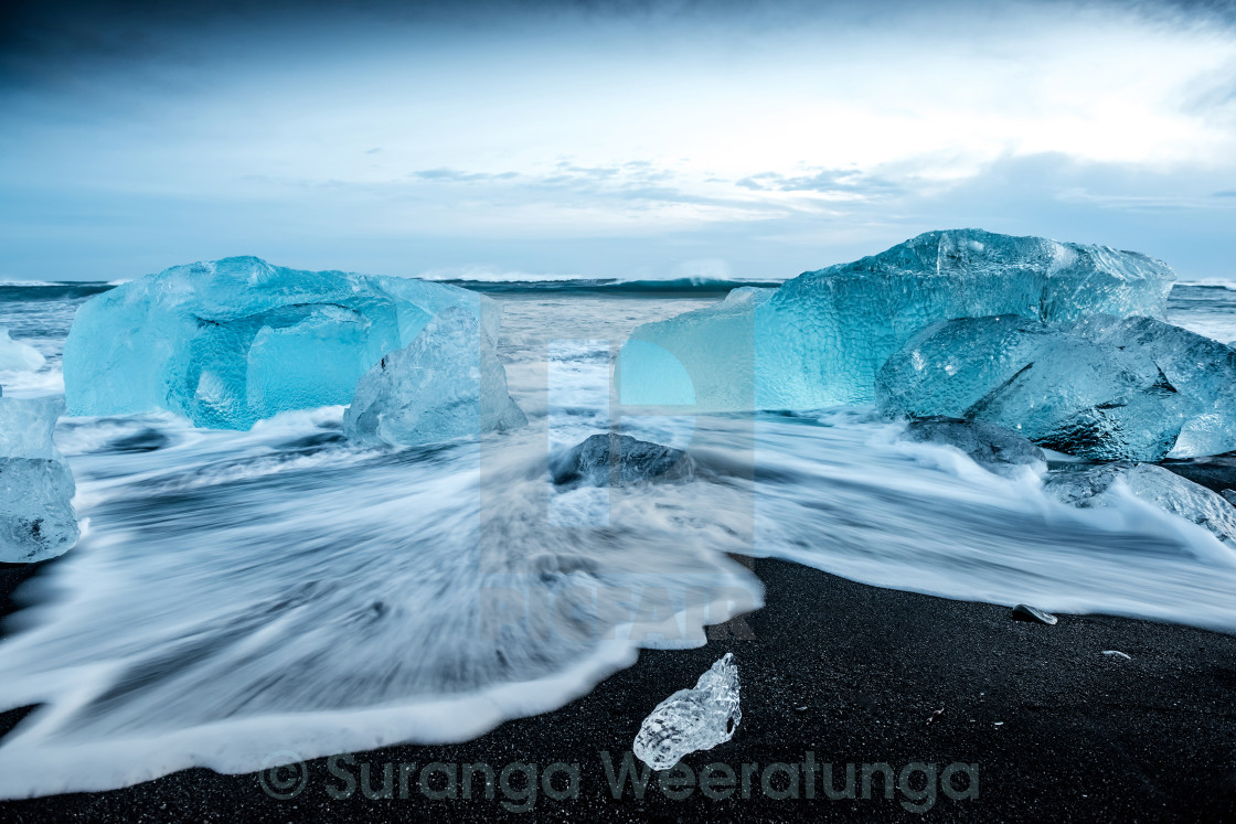 """Black beach and icebergs at crystal beach in Iceland"" stock image"