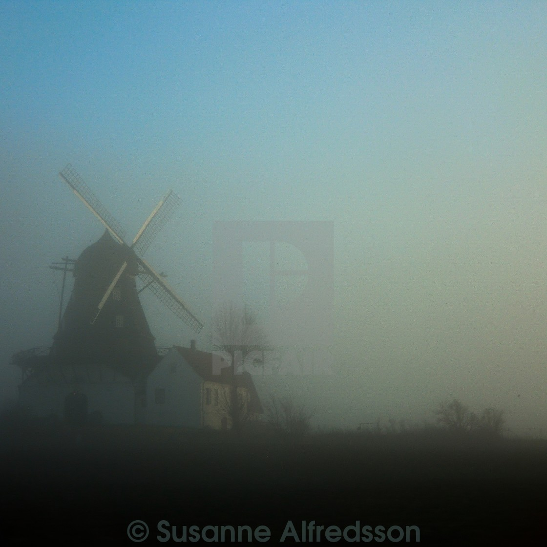"""Windmill in fog"" stock image"