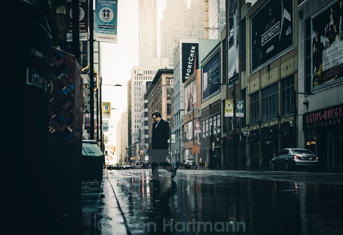 """Man crossing Street"" stock image"
