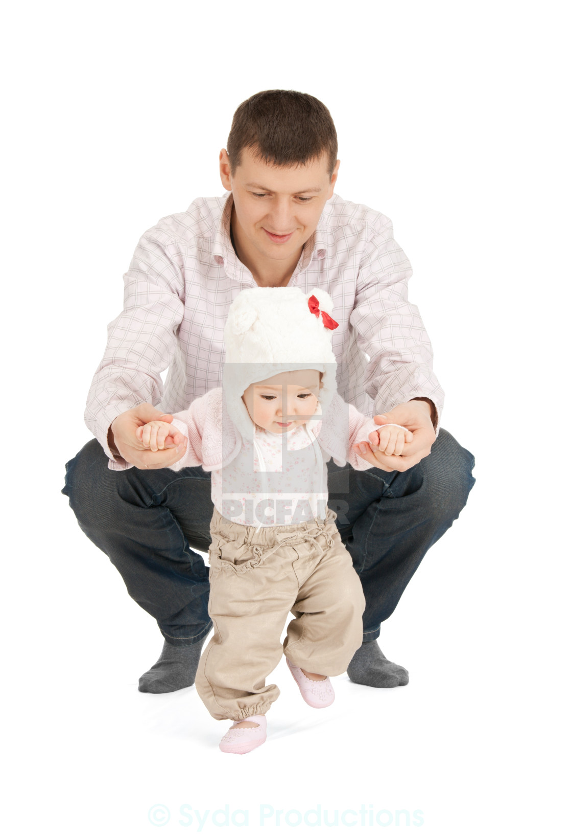 """baby making first steps with father help"" stock image"