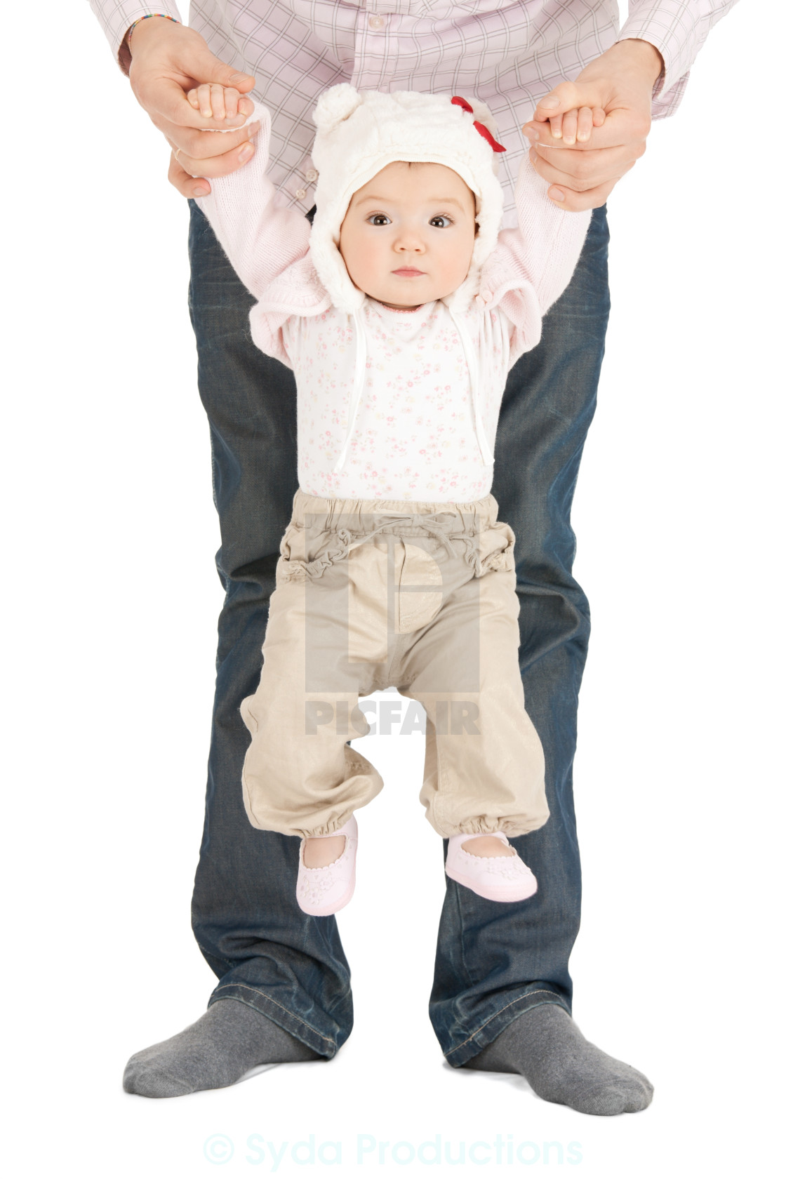 """""""baby hanging on fathers hands"""" stock image"""