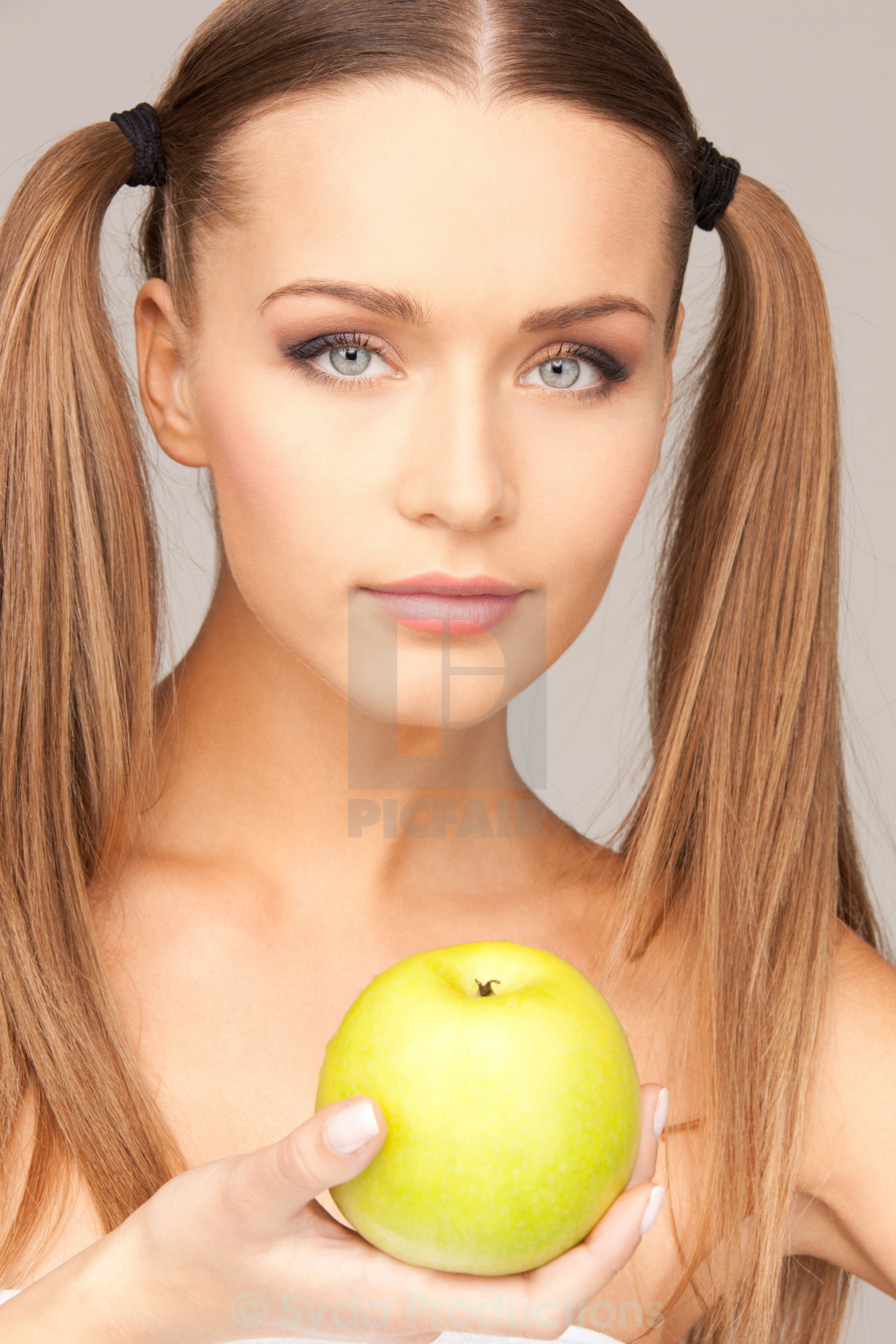 """""""young beautiful woman with green apple"""" stock image"""