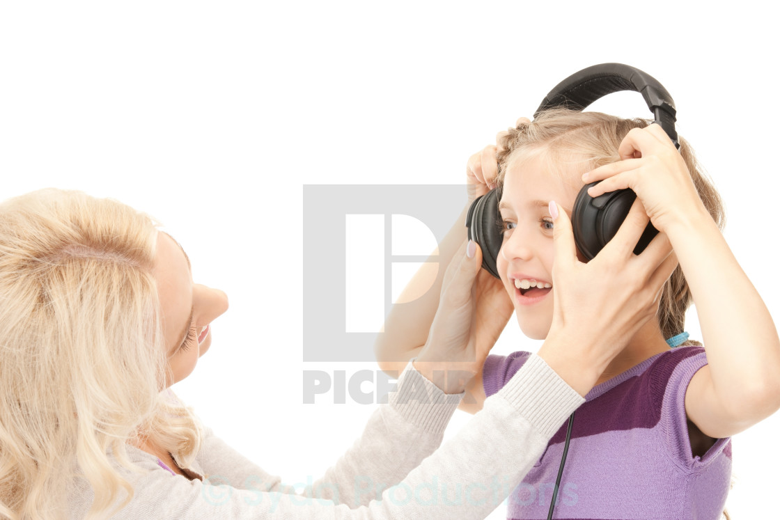 """""""mother and little girl with headphones"""" stock image"""