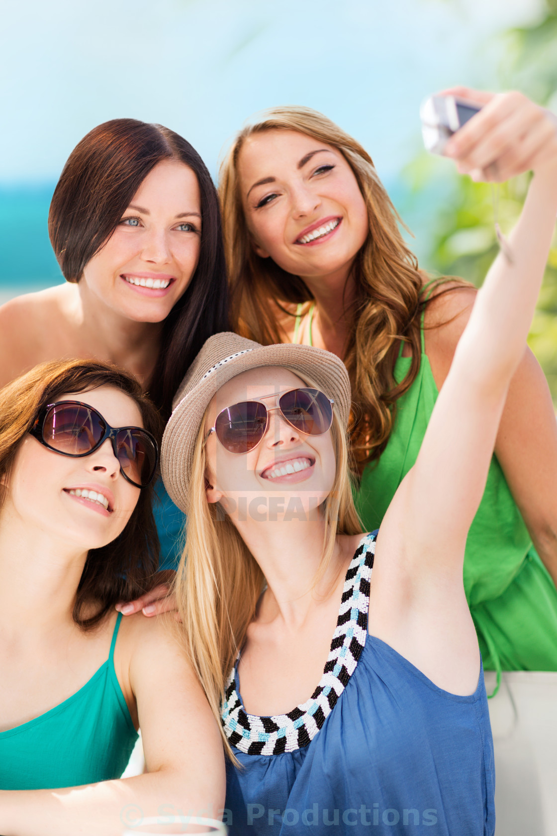 Girls Taking Photo In Cafe On The Beach License Download