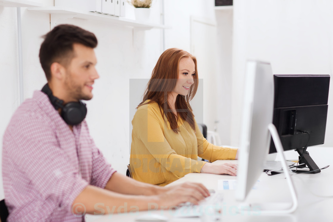 """creative team with headphones and computer"" stock image"