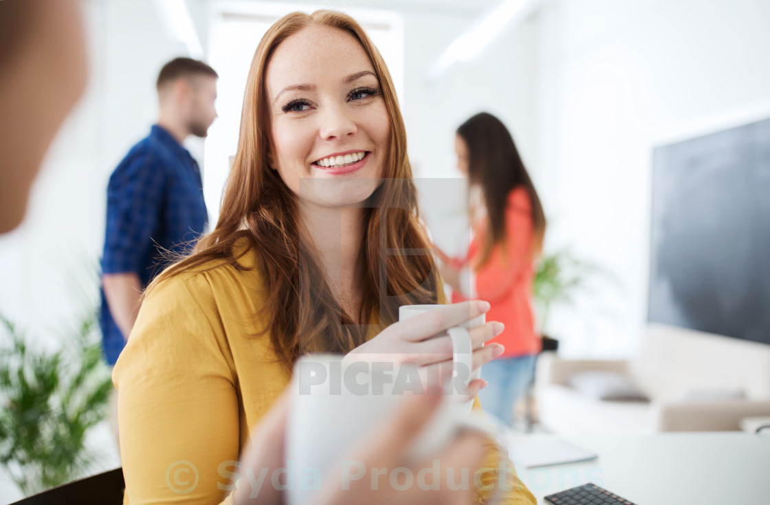 """""""happy creative team drinking coffee at office"""" stock image"""