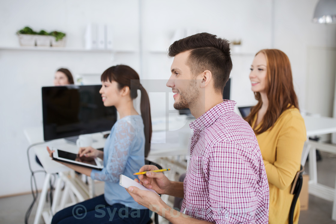 """creative team on conference or seminar at office"" stock image"