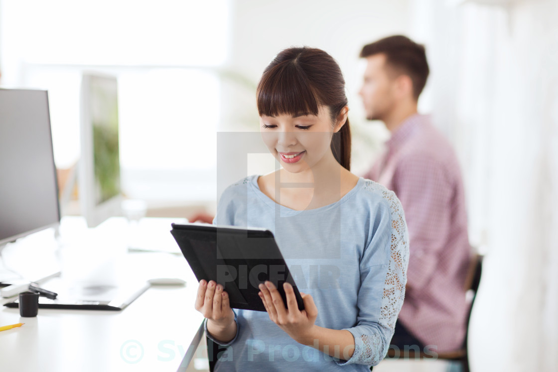 """happy creative female office worker with tablet pc"" stock image"