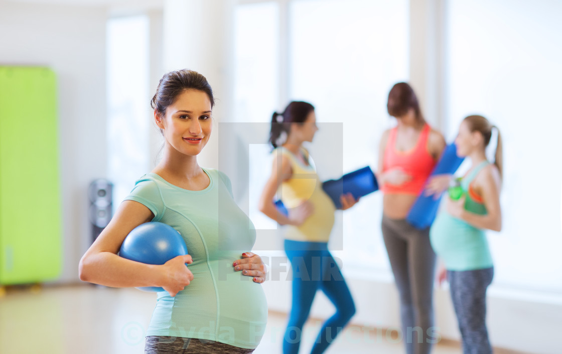 """""""happy pregnant woman with ball in gym"""" stock image"""