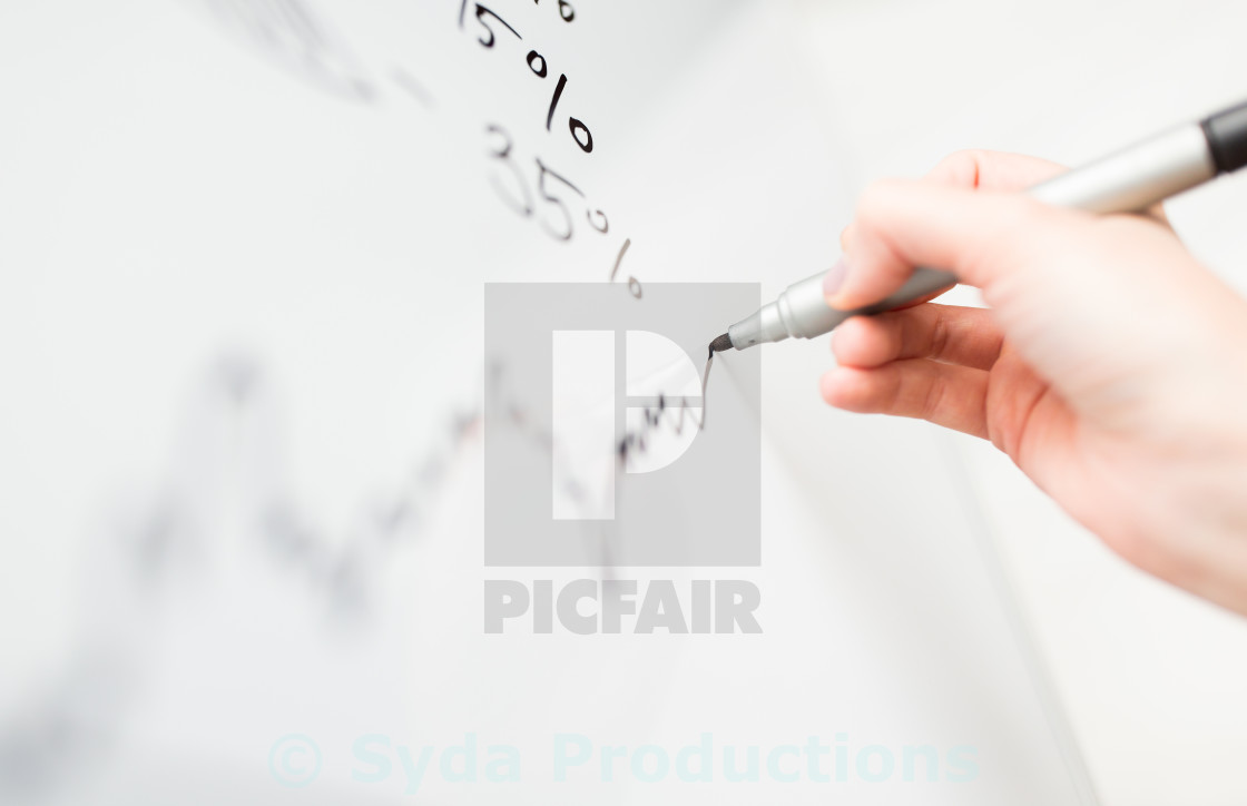 """close up of hand drawing graph on white board"" stock image"