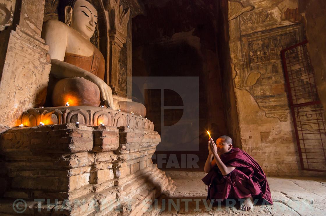 """Buddhist novice praying in pagoda at old bagan, mandalay, myanmar"" stock image"