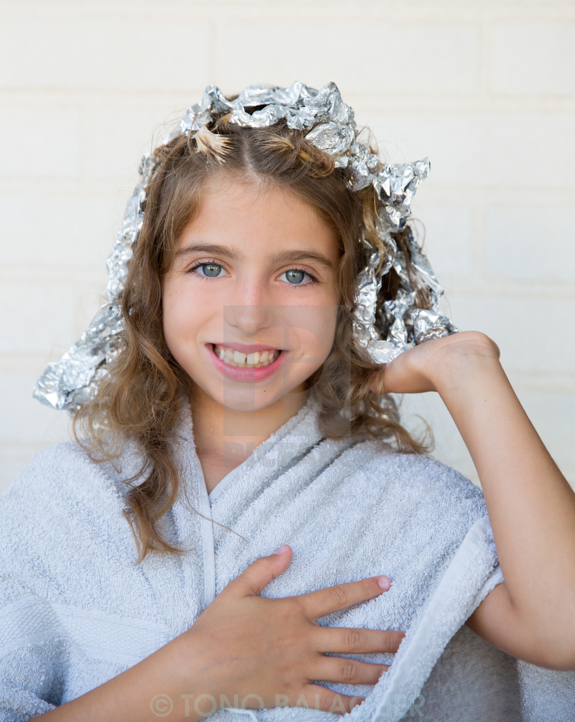 """""""Funny kid girl smiling with his dye hair with foil"""" stock image"""