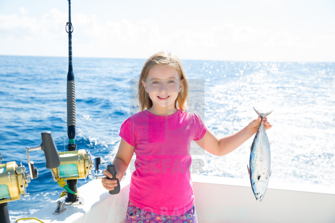 """""""Blond kid girl fishing tuna little tunny happy with catch"""" stock image"""