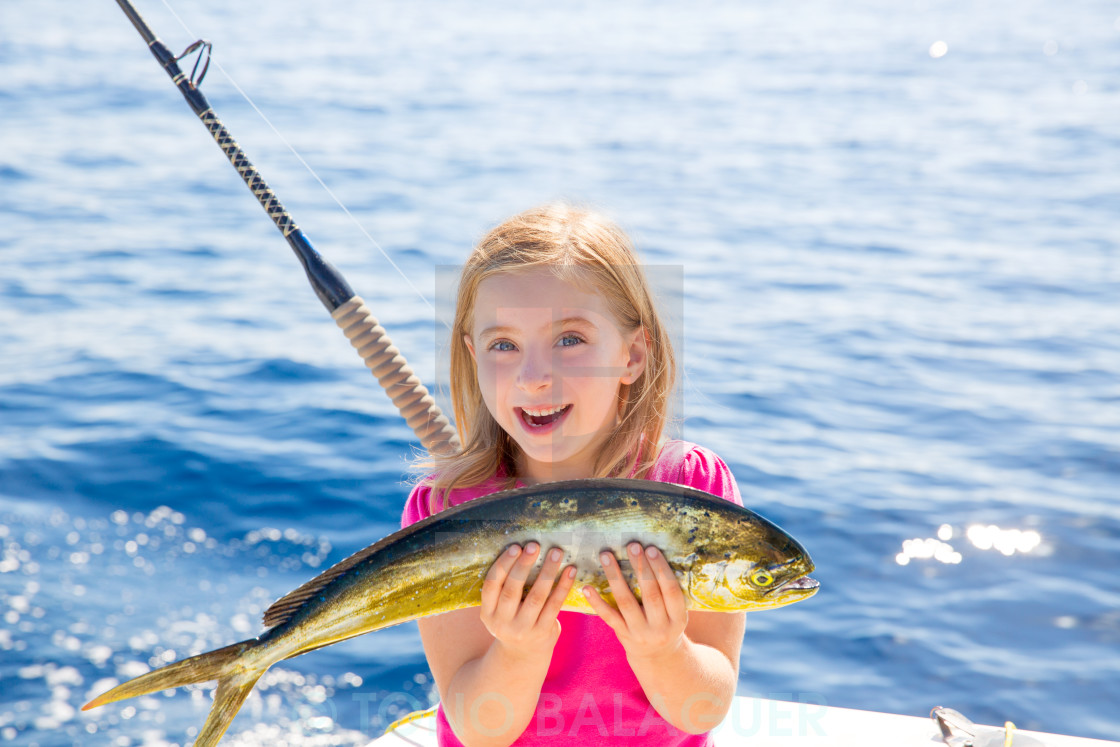 """Blond kid girl fishing Dorado Mahi-mahi fish happy catch"" stock image"