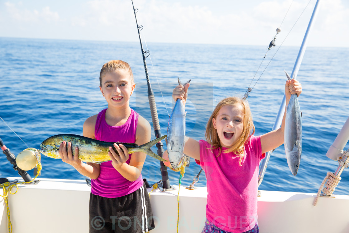 """Happy tuna fisherwomen kid girls with fishes catch"" stock image"