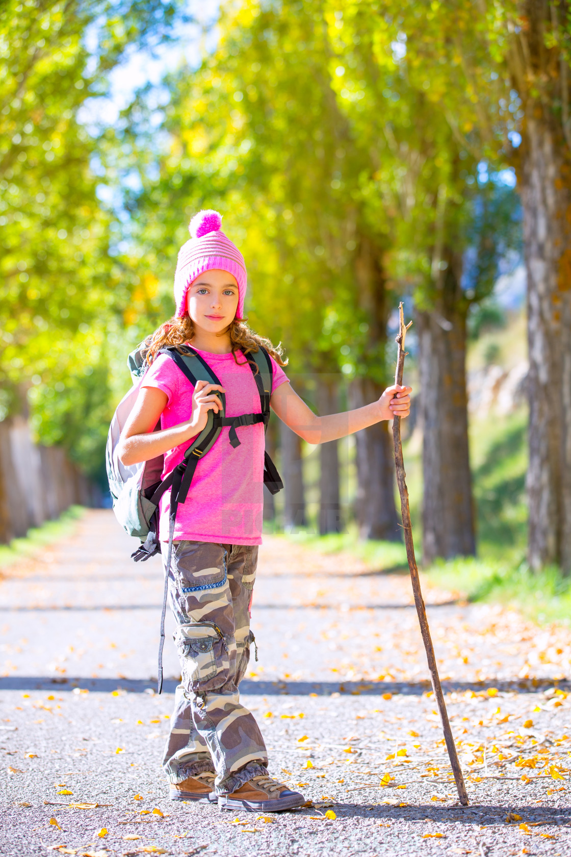 """""""hiking kid girl with walking stick and backpack in autumn"""" stock image"""