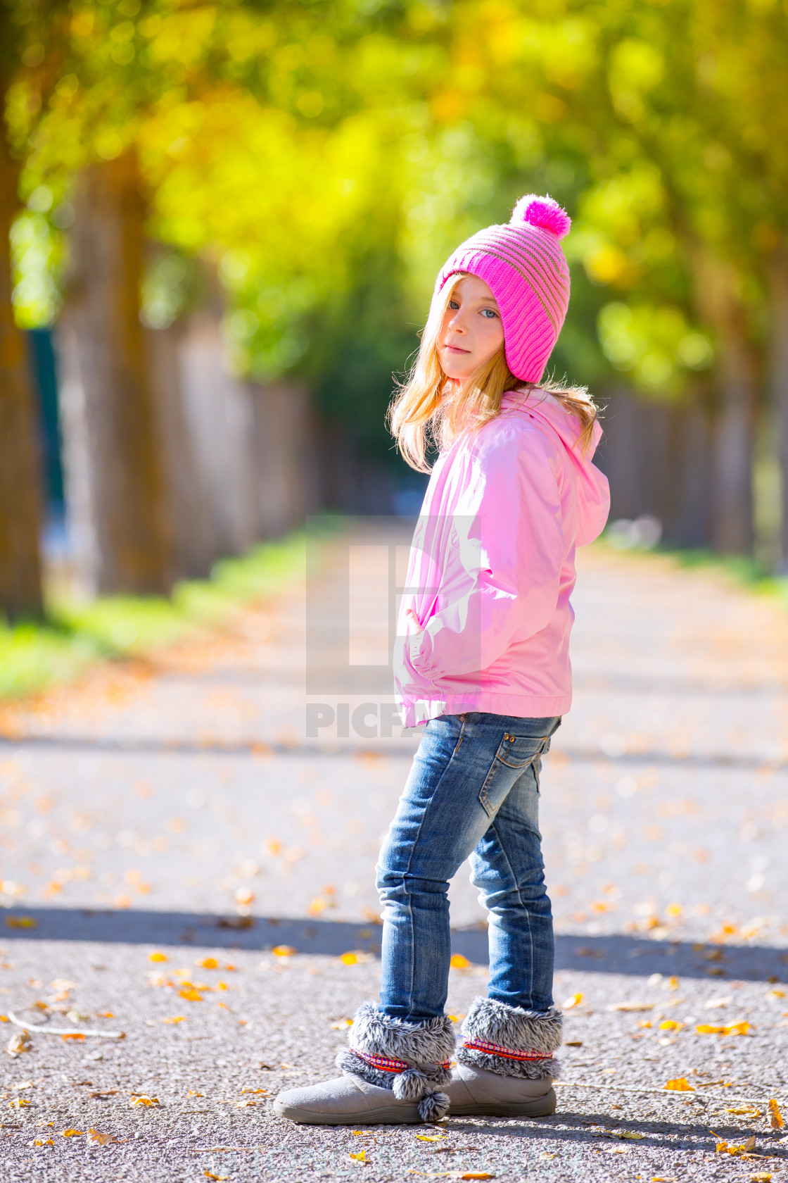 """autumn winter kid girl blond with jeans and pink snow cap"" stock image"