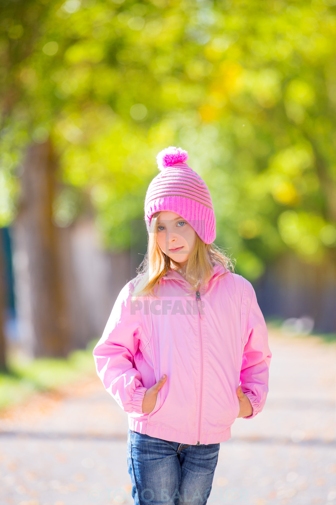 """""""autumn winter kid girl blond with jeans and pink snow cap"""" stock image"""
