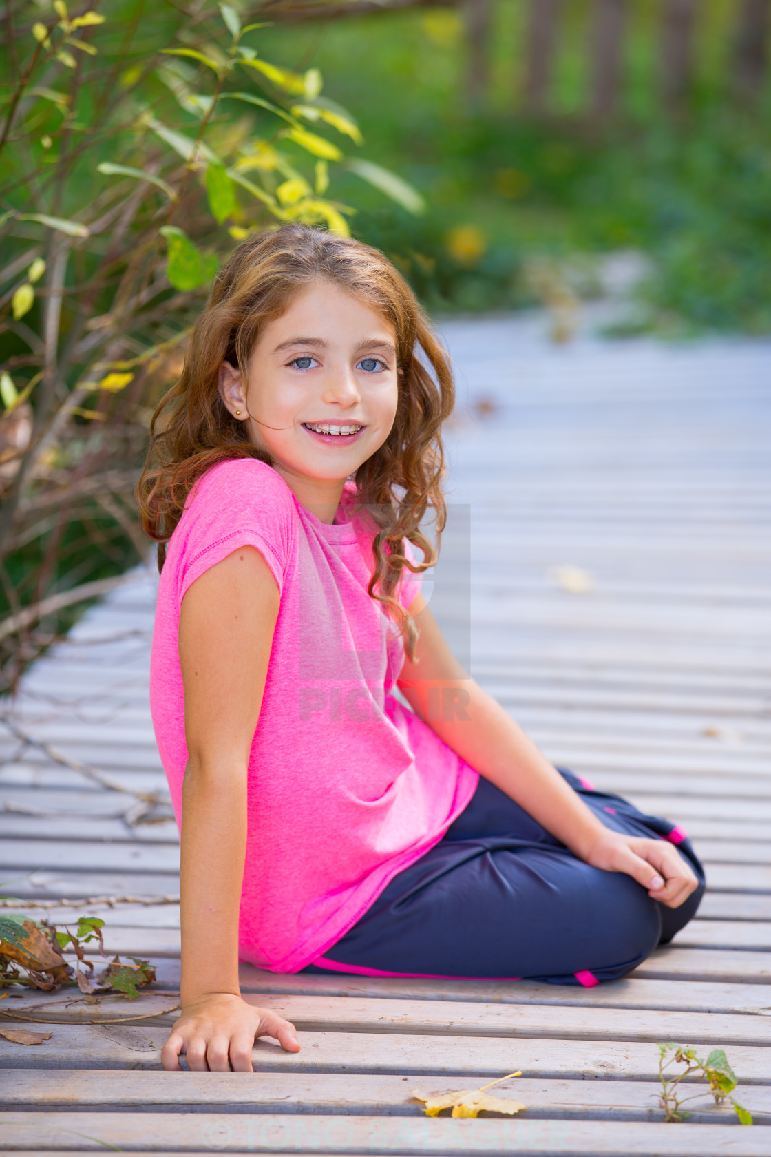 """""""Kid girl in autumn smiling with braces teeth apparatus"""" stock image"""