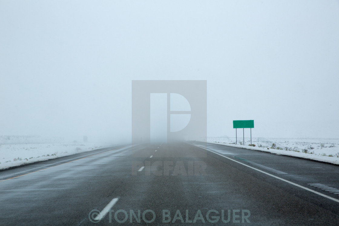 """US snowing I 15 interstate snowed road in Nevada"" stock image"