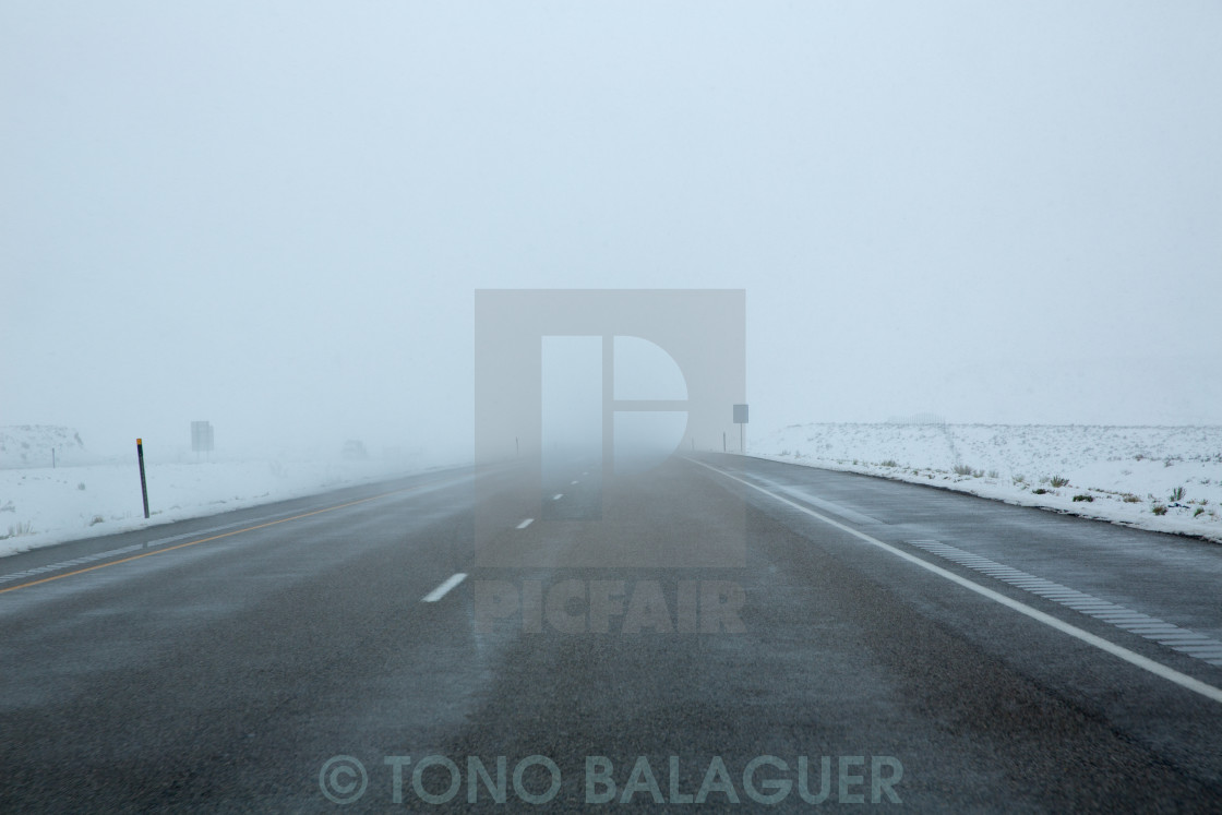 """""""US snowing I 15 interstate snowed road in Nevada"""" stock image"""