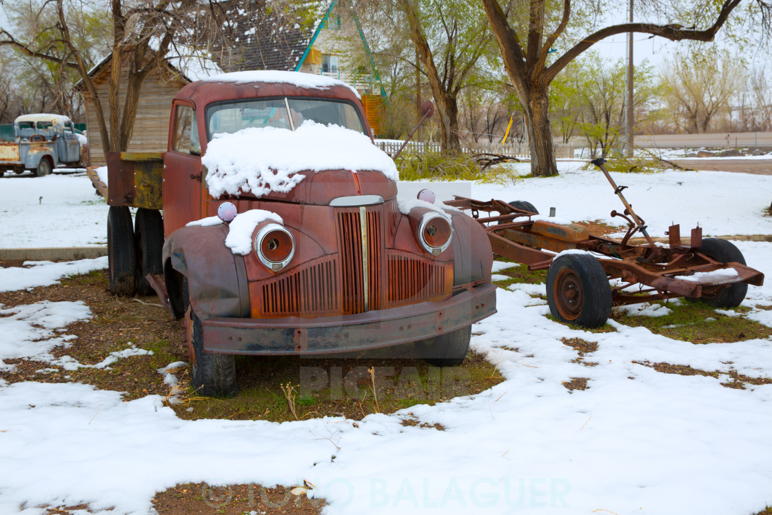 """""""Snow old truck in the early spring time in Nevada"""" stock image"""