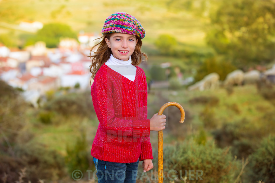 """Kid girl shepherdess with wooden baston in Spain village"" stock image"
