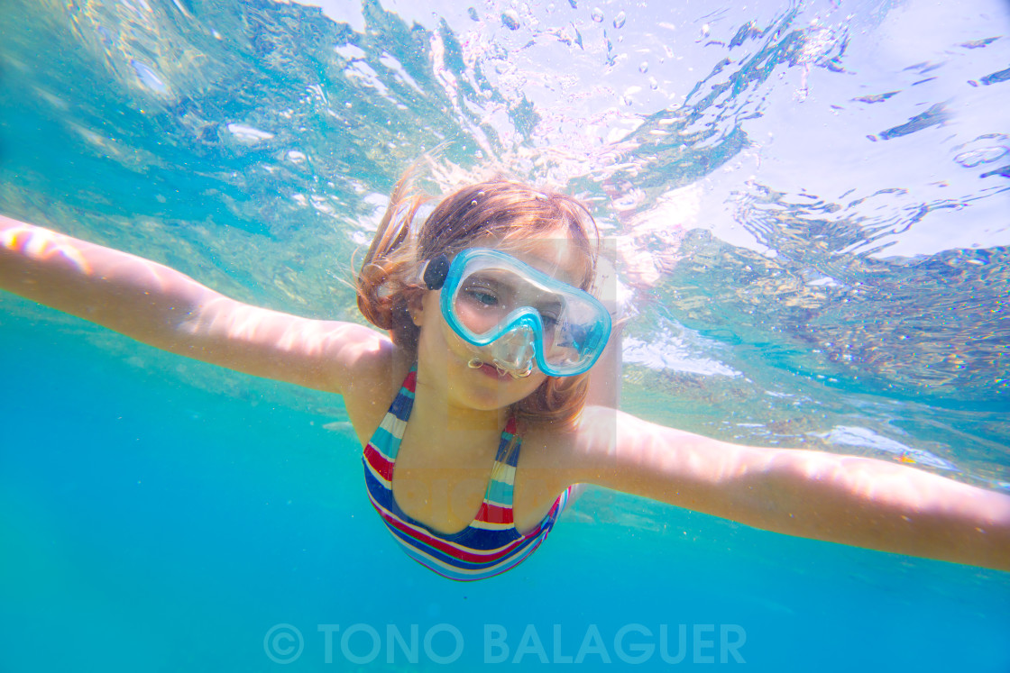"""snorkeling blond kid girl underwater goggles and swimsuit"" stock image"