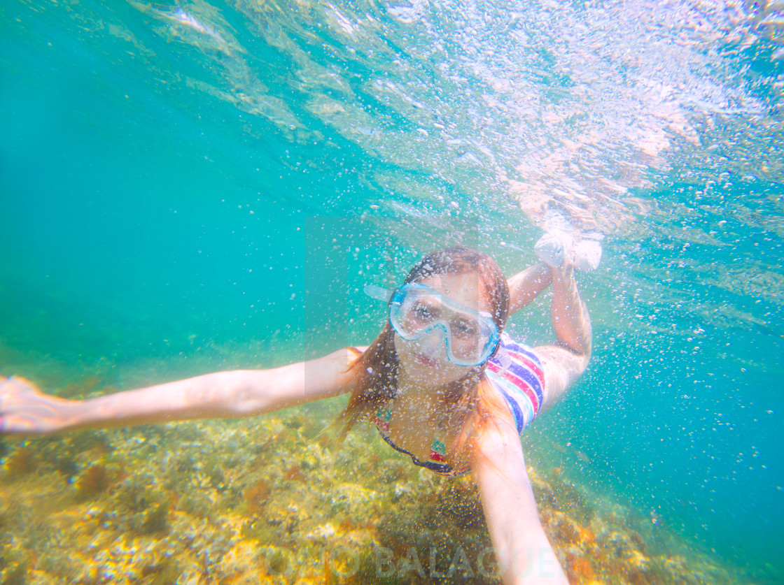 """""""snorkeling blond kid girl underwater goggles and swimsuit"""" stock image"""
