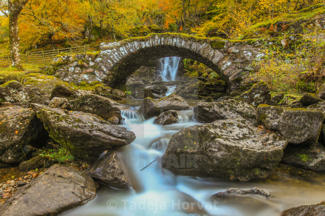 """Falls of Allt da Ghob and Roman bridge in Glen Lyon"" stock image"