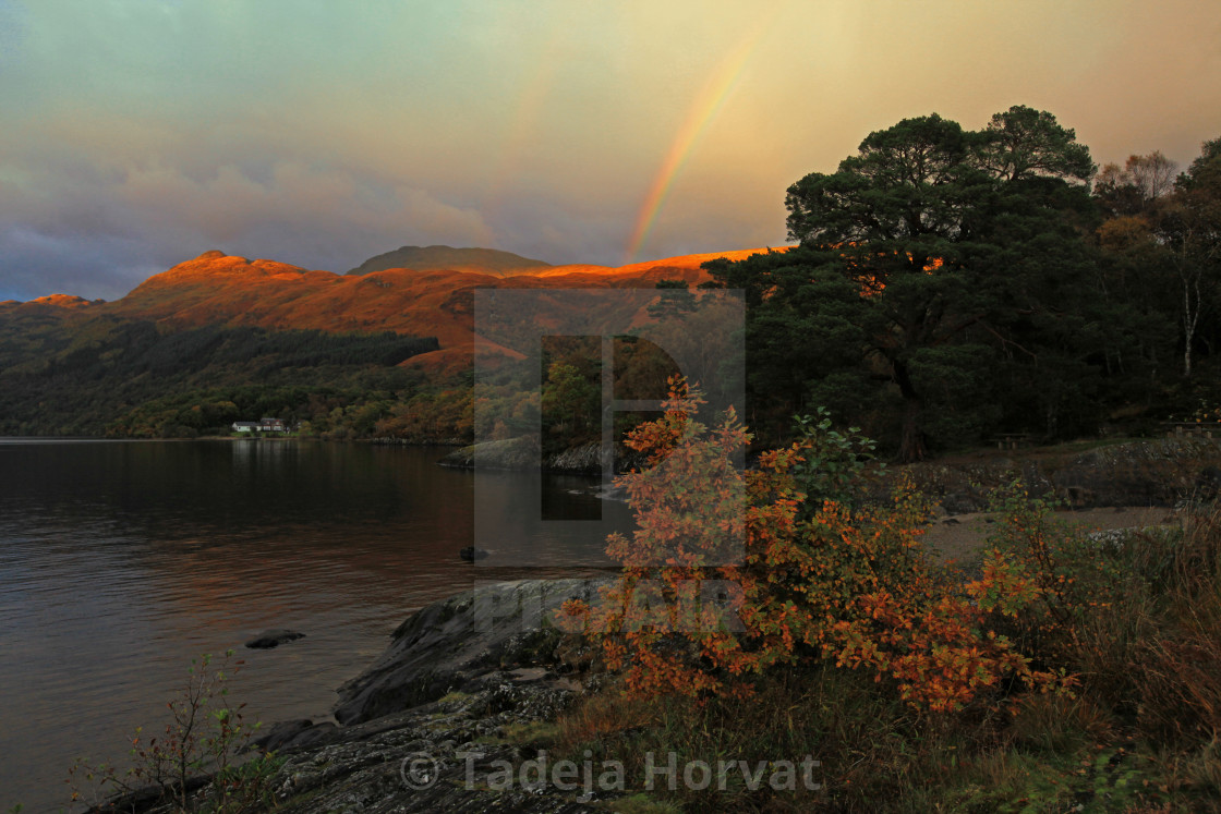 """Rainbow over Ben Lomond"" stock image"