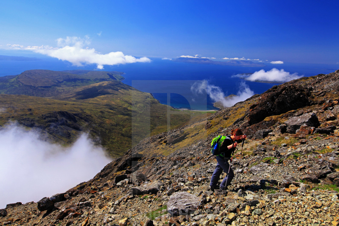 """Hiker on their way up to Bla Bheinn (Blaven), Isle of Skye"" stock image"