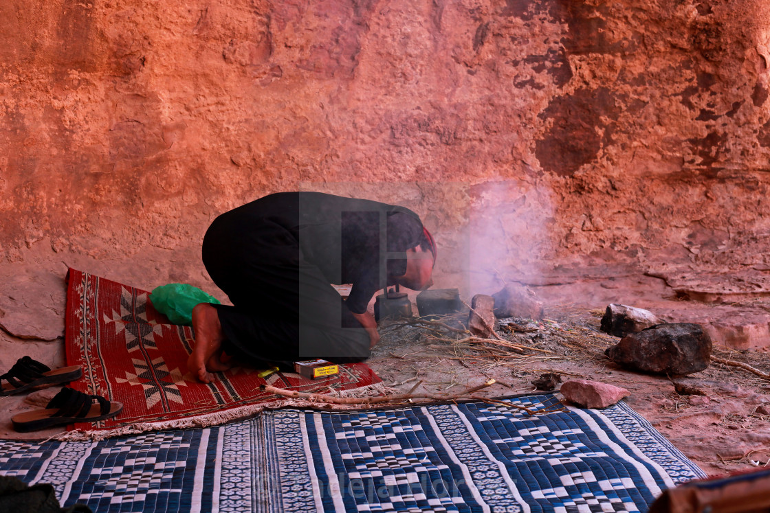 """Bedouin cooks lunch in the desert"" stock image"