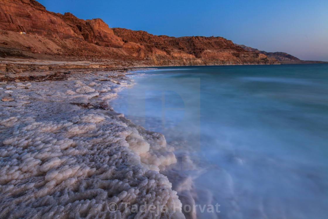"""Sunset view of salt formations in the Dead Sea"" stock image"