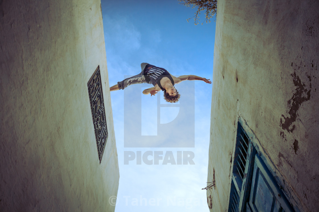"""Taher Nagati flying between buildings"" stock image"
