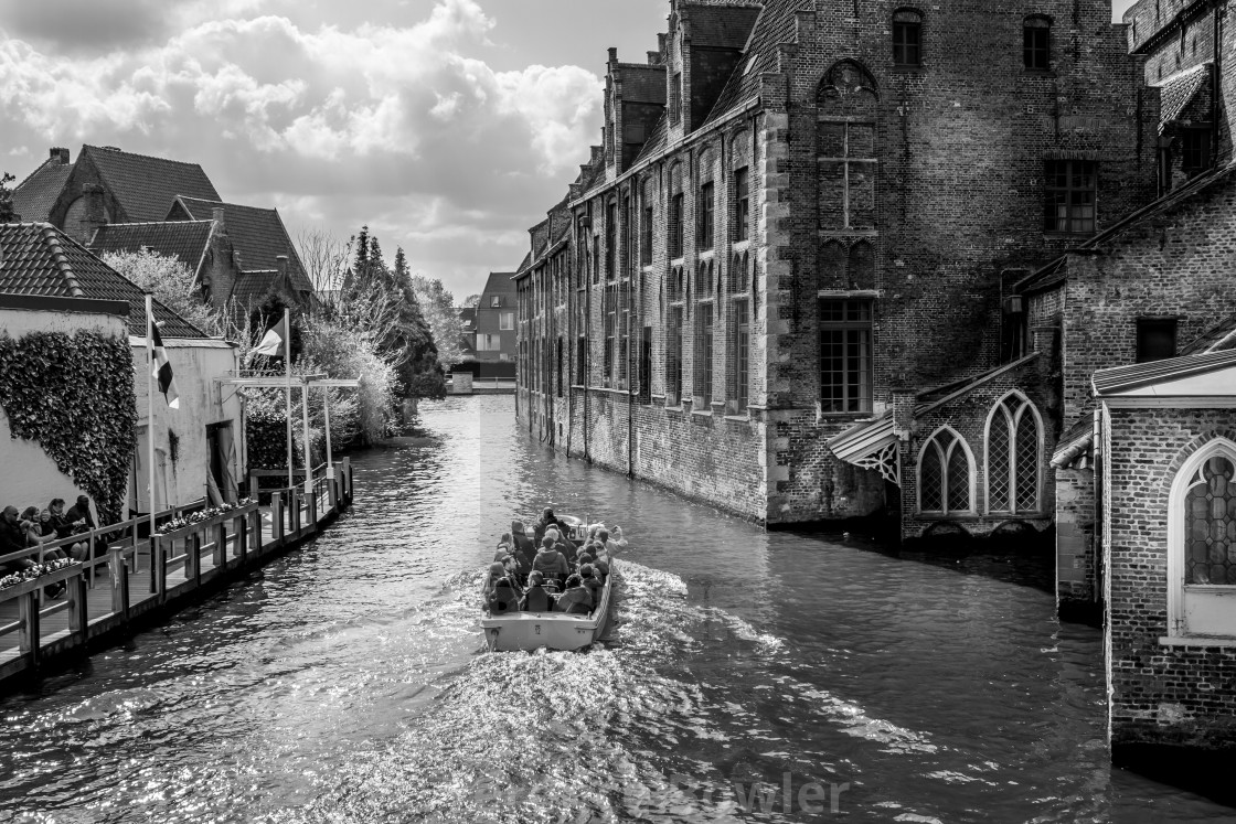 """Boat on Canal in Bruges"" stock image"