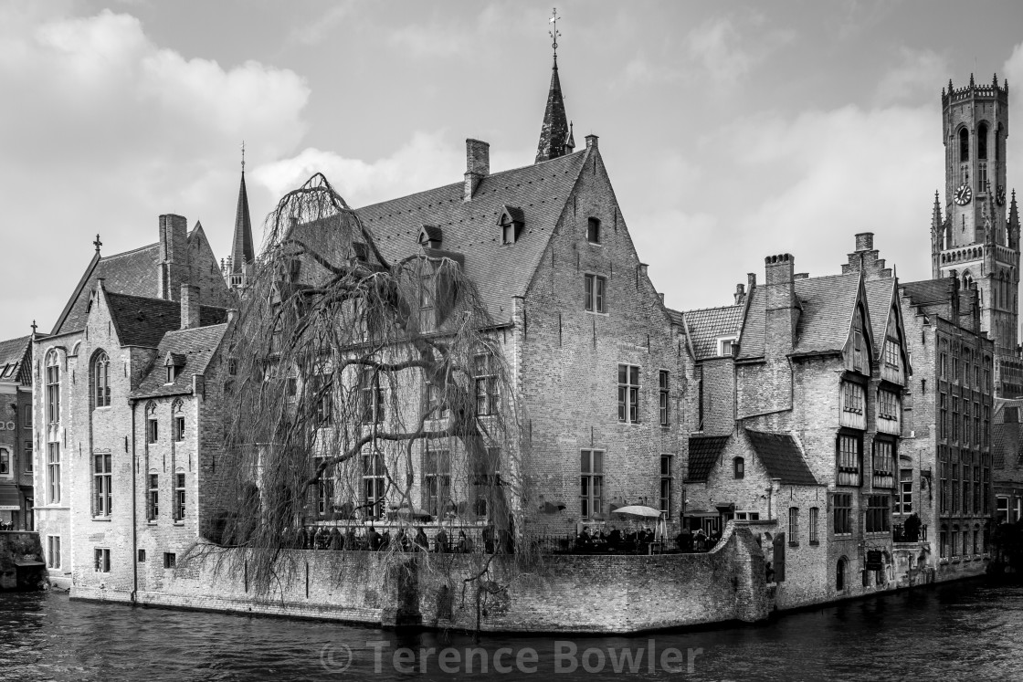 """Buildings on a canal in Bruges"" stock image"