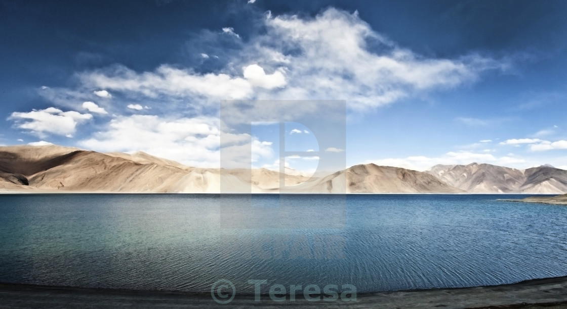 """Clear blue lake with mountains"" stock image"