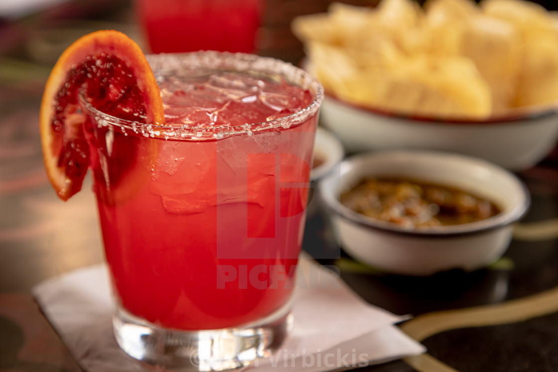 """""""Blood orange margarita with chips and salsa"""" stock image"""