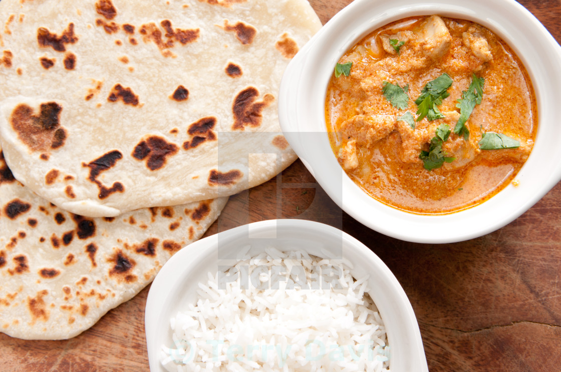 """butter chicken and naan"" stock image"