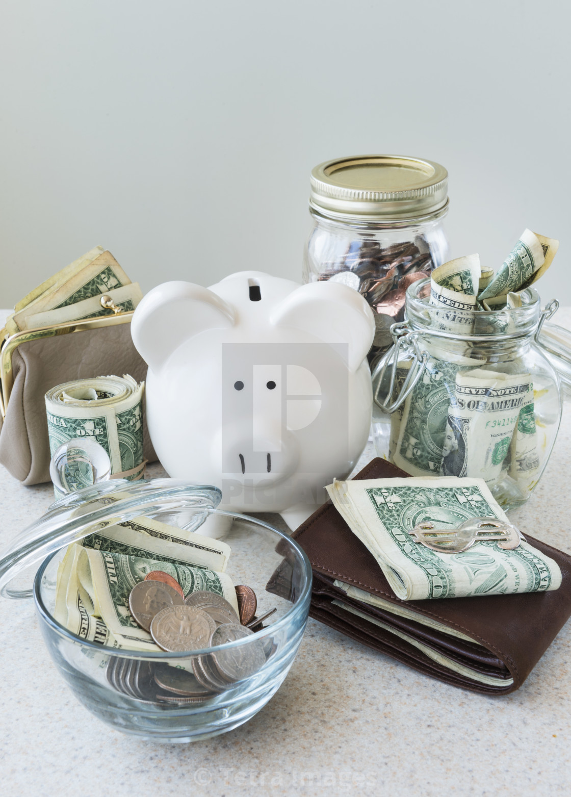 """Studio shot of savings in jars"" stock image"